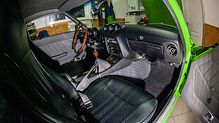 Green Datsun 240z interior with black grey leather