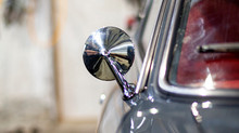 A magnificent chrome bullet mirror shining on a beautiful Datsun 260z 1974 in grey