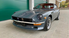 Side view of a 1974 Nissan Datsun 260z grey japanese classic car restored