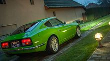Rear of a Green Datsun 240z japanese classic car restored