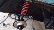 Front suspension being refurbished on this complete nut and bolt restoration of a Datsun 260z for sale.